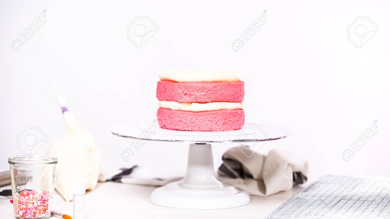 Step By Stacking Layers Together Of Pink Birthday Cake