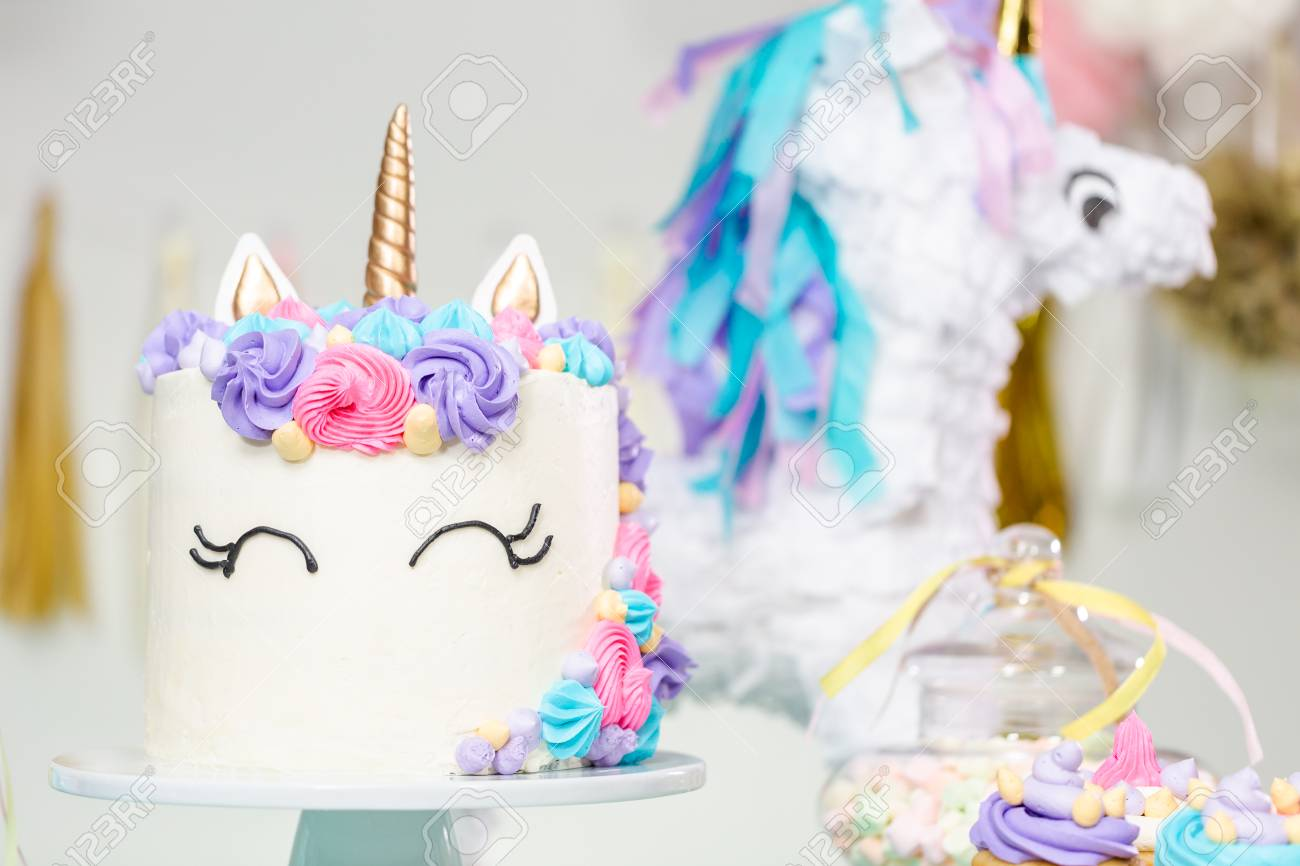 Little Girl Birthday Party Table With Unicorn Cake Cupcakes And Sugaer Cookies Standard