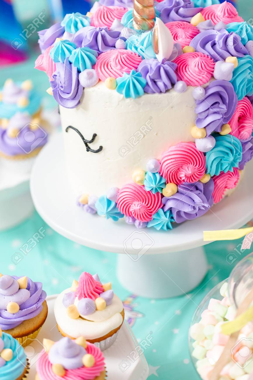 Little Girl Birthday Party Table With Unicorn Cake Cupcakes And Sugaer Cookies Stock