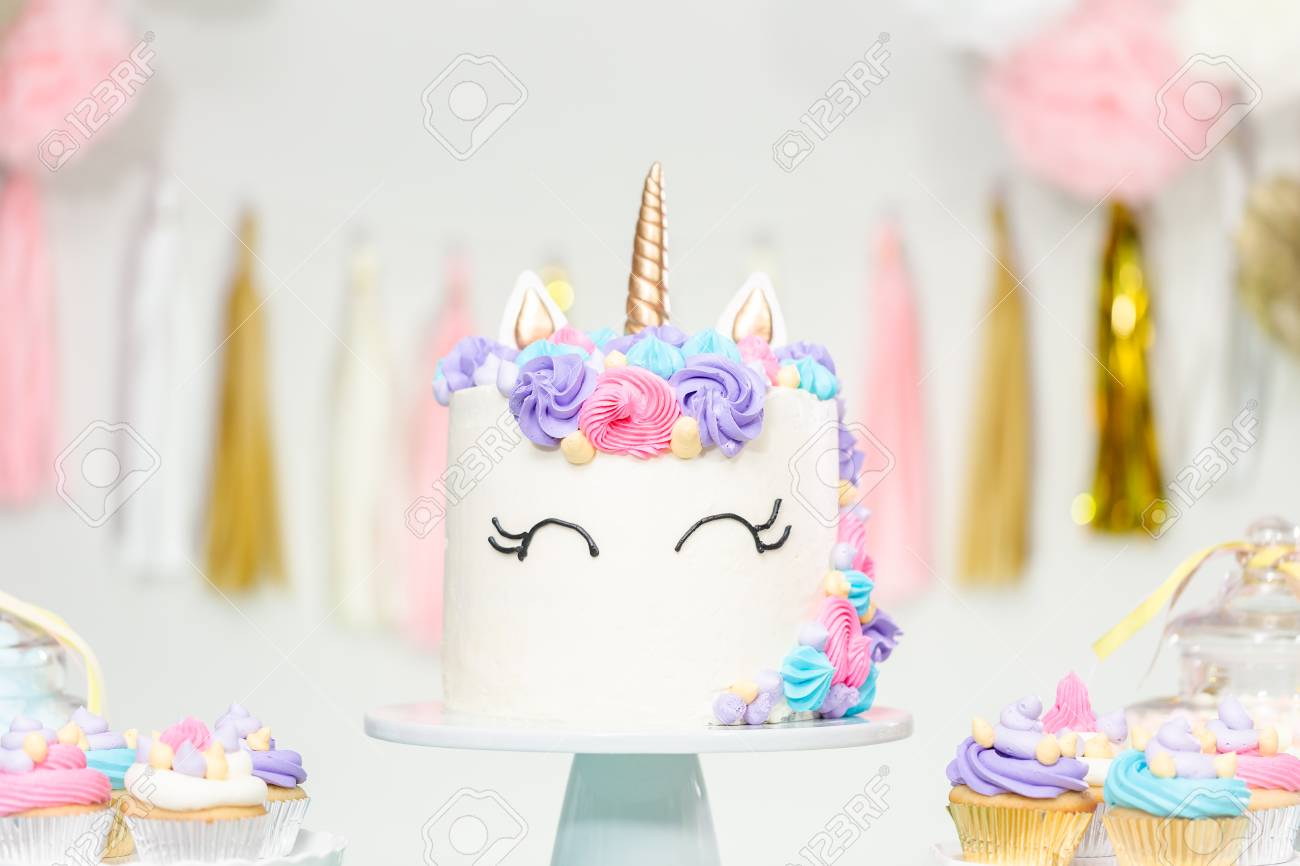 Little Girl Birthday Party Table With Unicorn Cake Cupcakes And Sugar Cookies Stock
