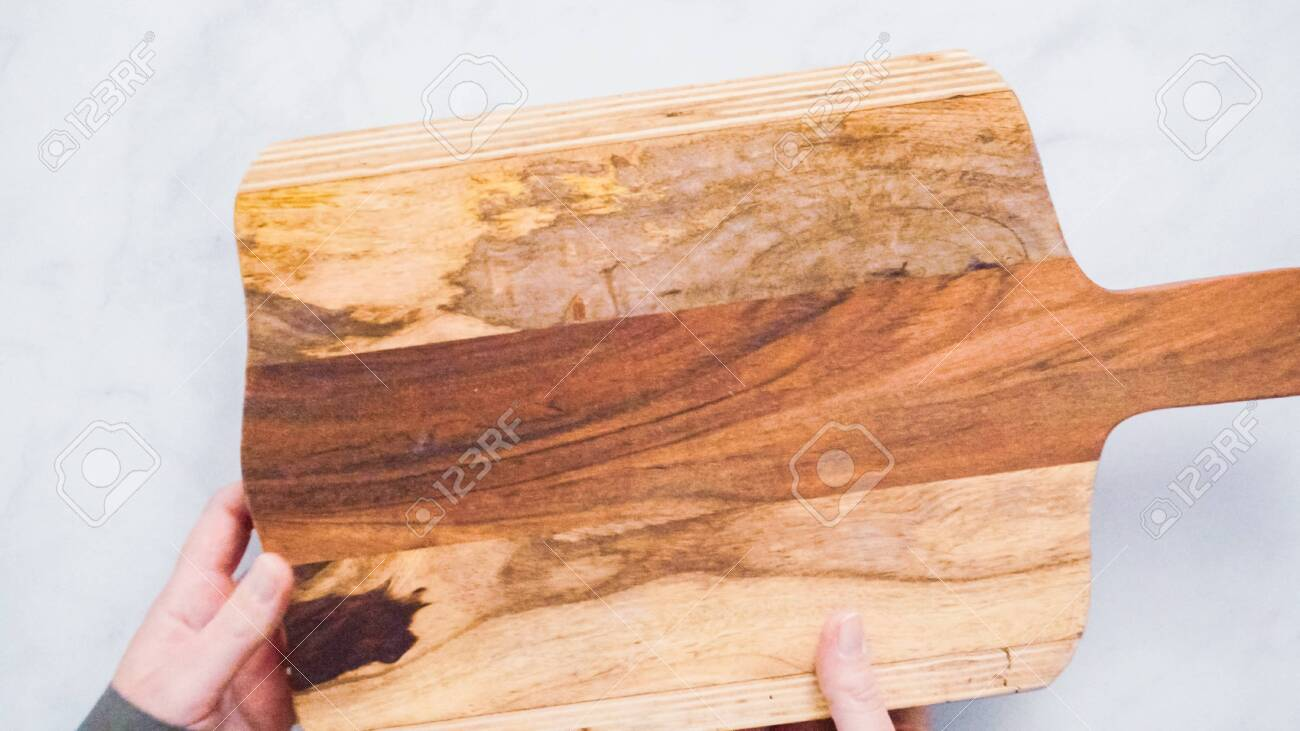 Rustic Wood Cutting Board On Marble Kitchen Counter Stock Photo Picture And Royalty Free Image Image 112033646