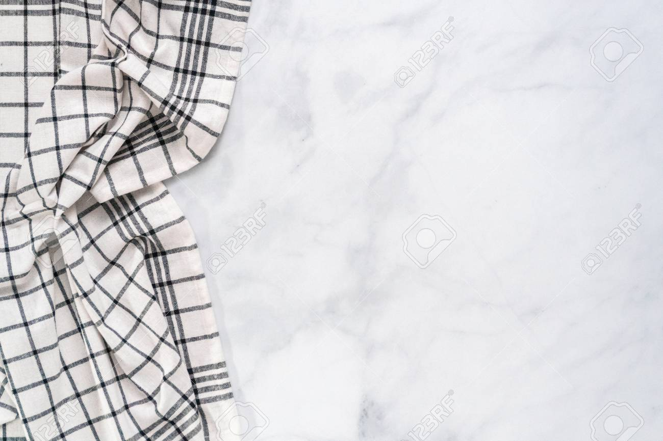 New kitchen towels with simple black pattern folded on marble counter. - 112178337
