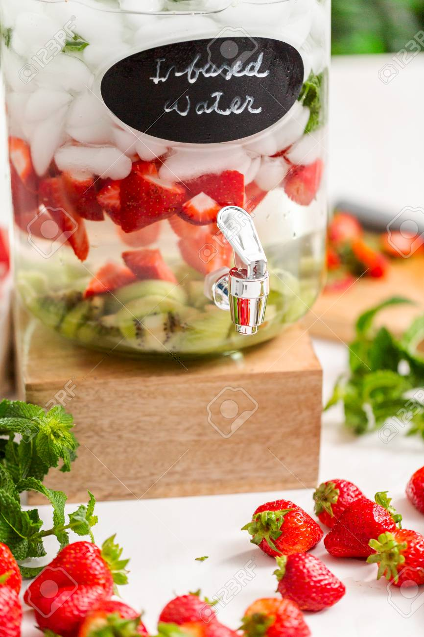 Infused Water With Organic Strawberries Kiwi And Fresh Mint