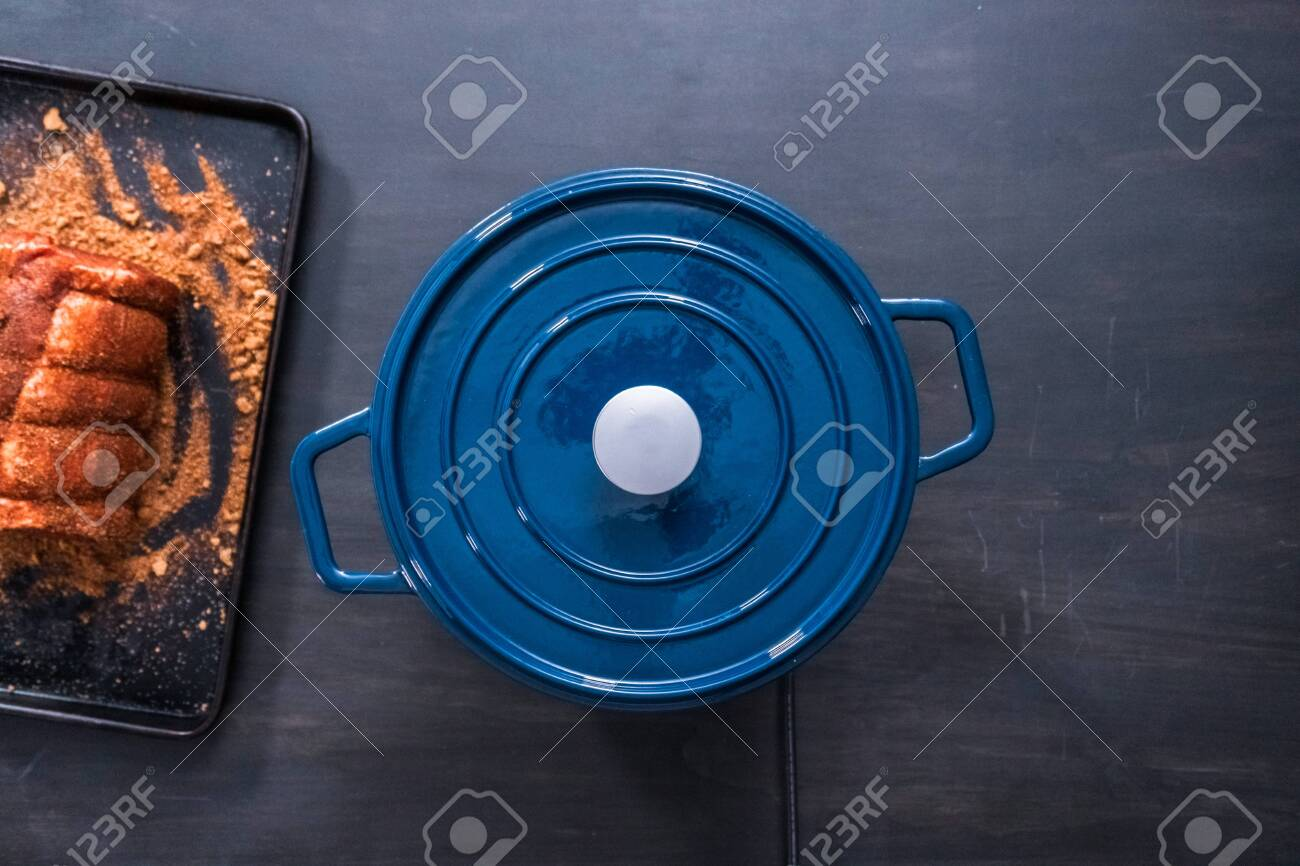 Flat Lay Cooking Boneless Pork Roast In Enameled Cast Iron Covered Stock Photo Picture And Royalty Free Image Image 116981155