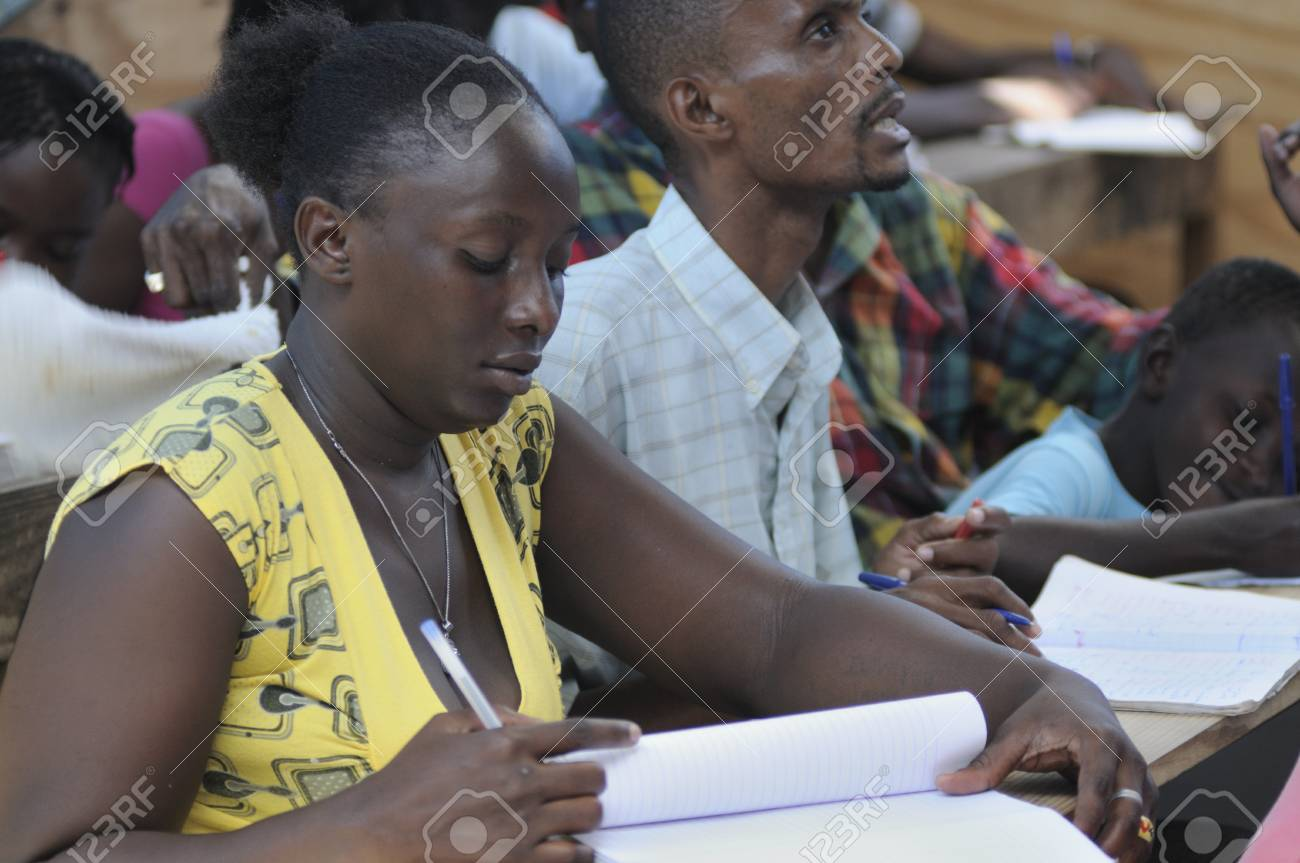 CITE SOLEIL- AUGUST 25: Mature students learning english in a local community school in Cite Soleil- one of the poorest area in the Western Hemisphere on August 25 2010 in Cite Soleil, Haiti. Stock Photo - 15240162