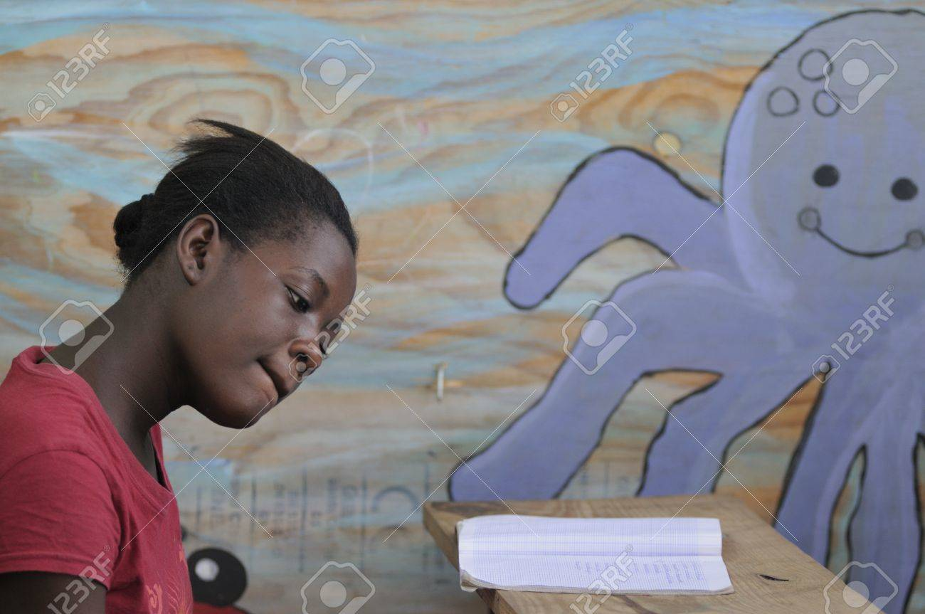 CITE SOLEIL- AUGUST 25: A female student doing her class work in a local community school in Cite Soleil- one of the poorest area in the Western Hemisphere on August 25 2010 in Cite Soleil, Haiti. Stock Photo - 15240158