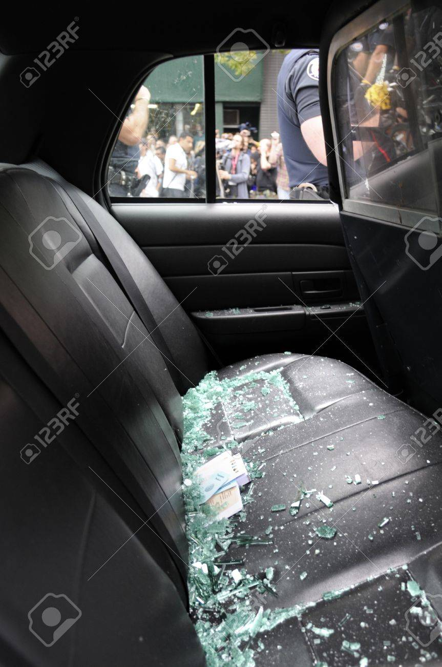 TORONTO JUNE 26 Broken Glasses Lie Of The Back Seat A Police