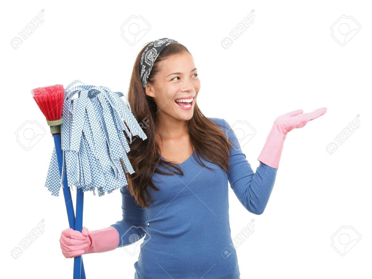 Young asian woman cleaning and presenting your product or message at the side. Isolated on white background. Stock Photo - 6190819