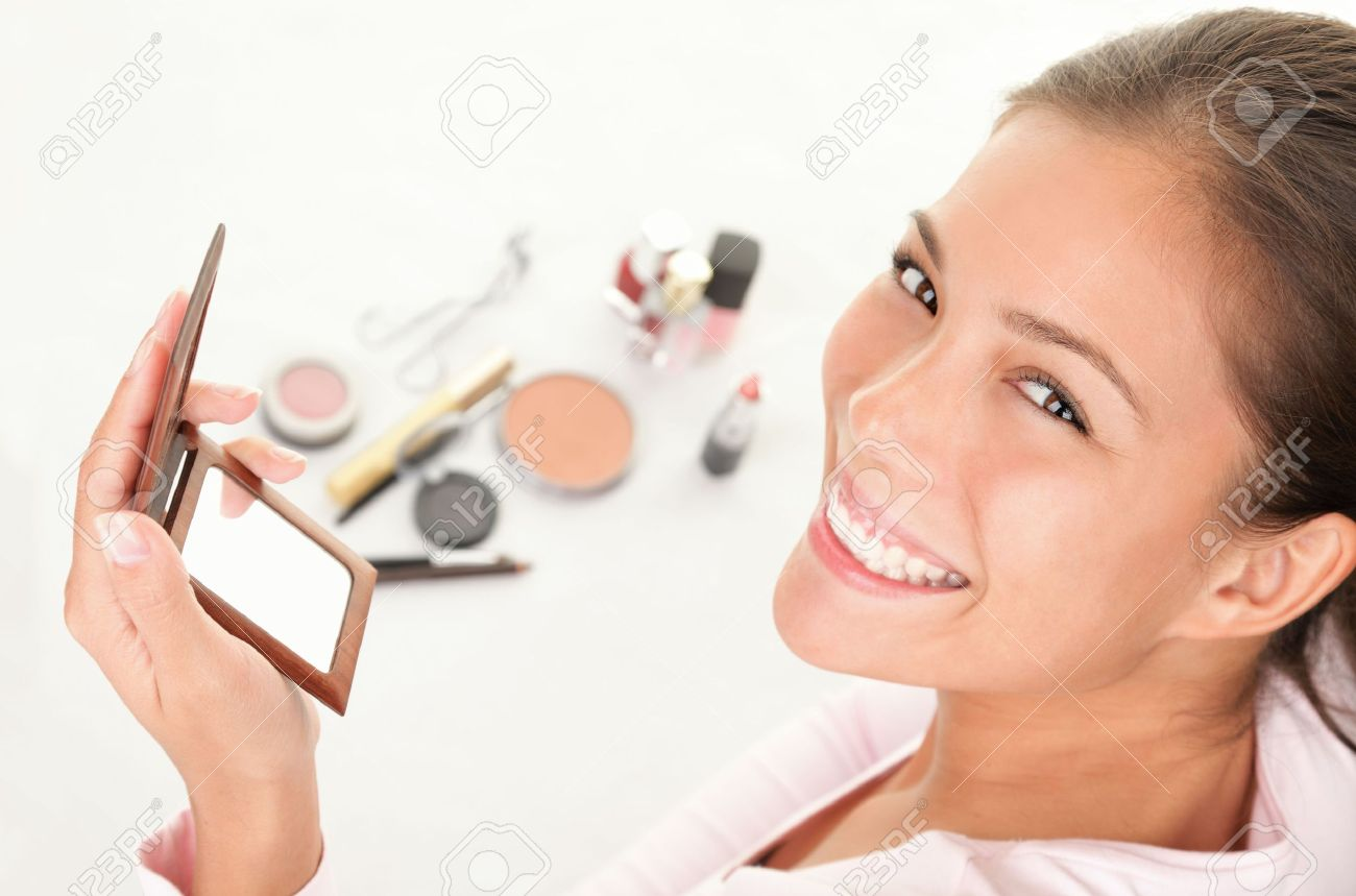 Makeup woman. Cute cosmetics woman having fun with make-up products. Stock Photo - 6305254