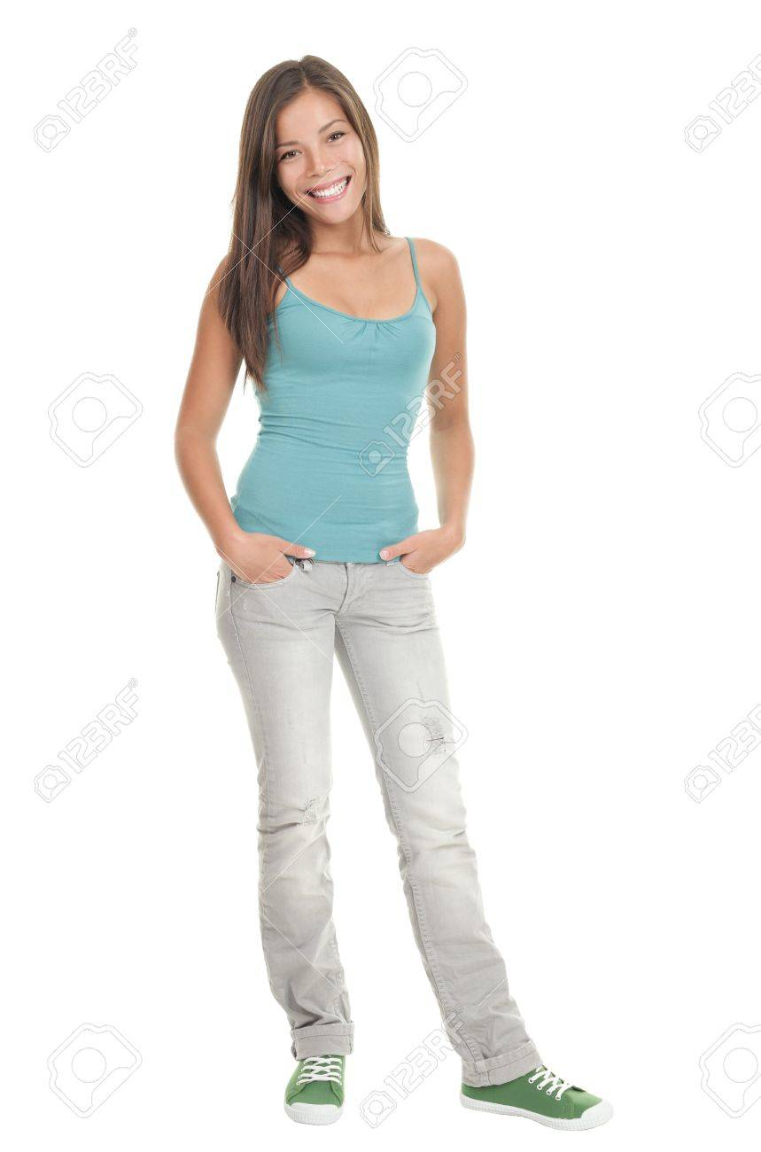 Young woman in standing casual and isolated in full length. Smiling and looking gorgeous. Beautiful cute mixed race caucasian / chinese young woman model. Stock Photo - 6360174