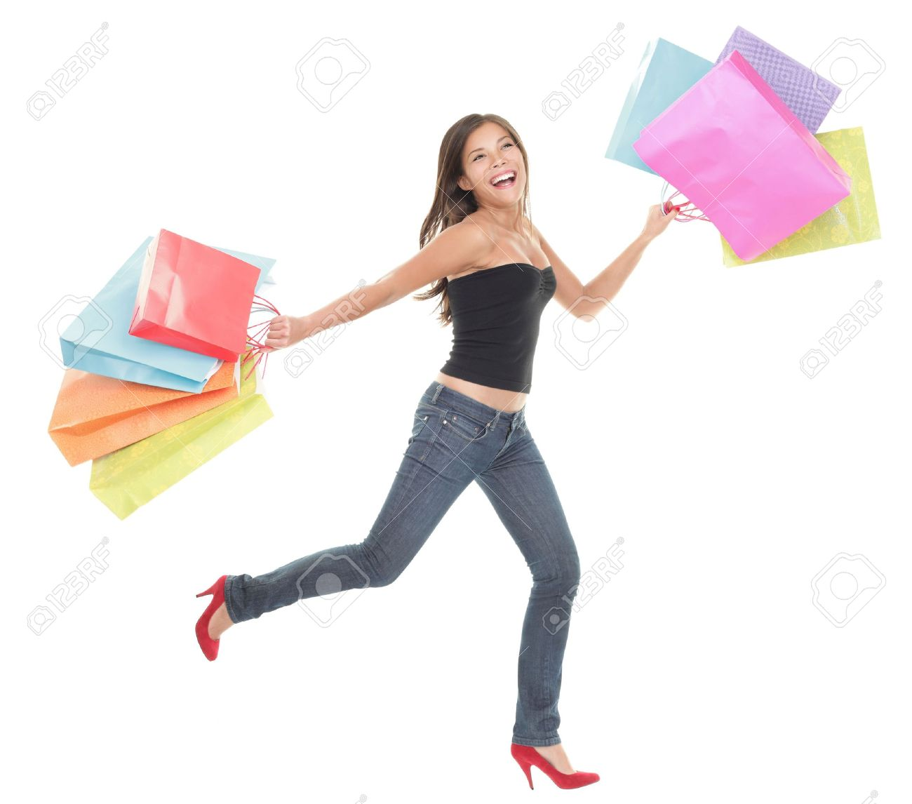 Shopping woman  Cheerful young woman running and jumping of joy