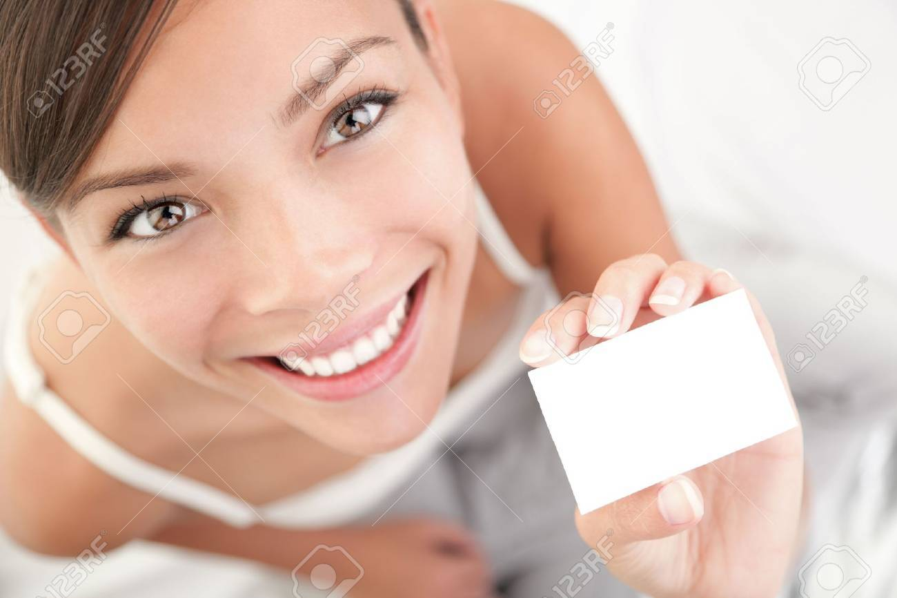 Casual business card woman. High angle view of beautiful mixed race Asian Chinese / Caucasian young woman. Stock Photo - 6813851