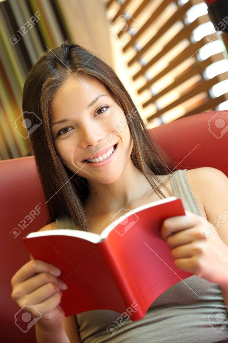 Woman reading a book at home. Young beautiful Caucasian / Asian female model Stock Photo - 7780055