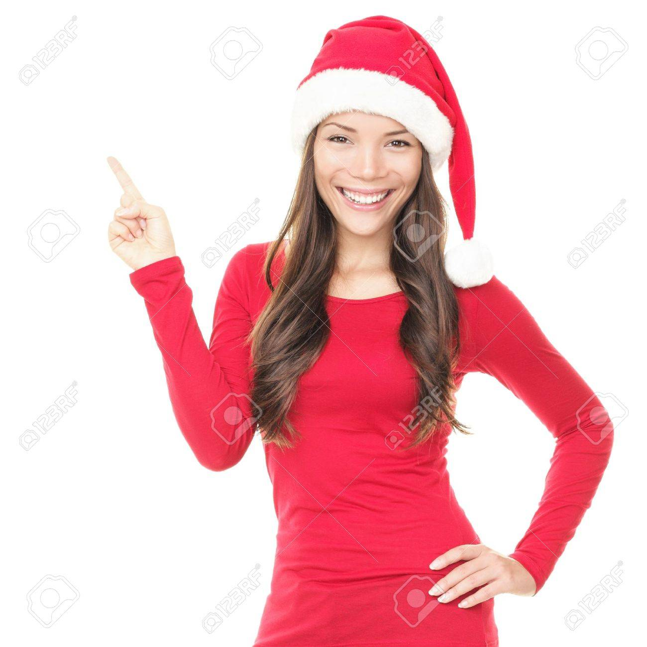 Beautiful smiling christmas santa woman pointing up showing copyspace. Isolated on white background. Stock Photo - 8153456