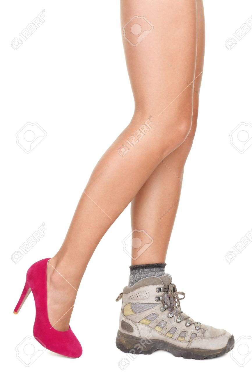 Shoe choice concept image. Sexy woman legs wearing one high heels shoe and one hiking shoe. Stock Photo - 8294715