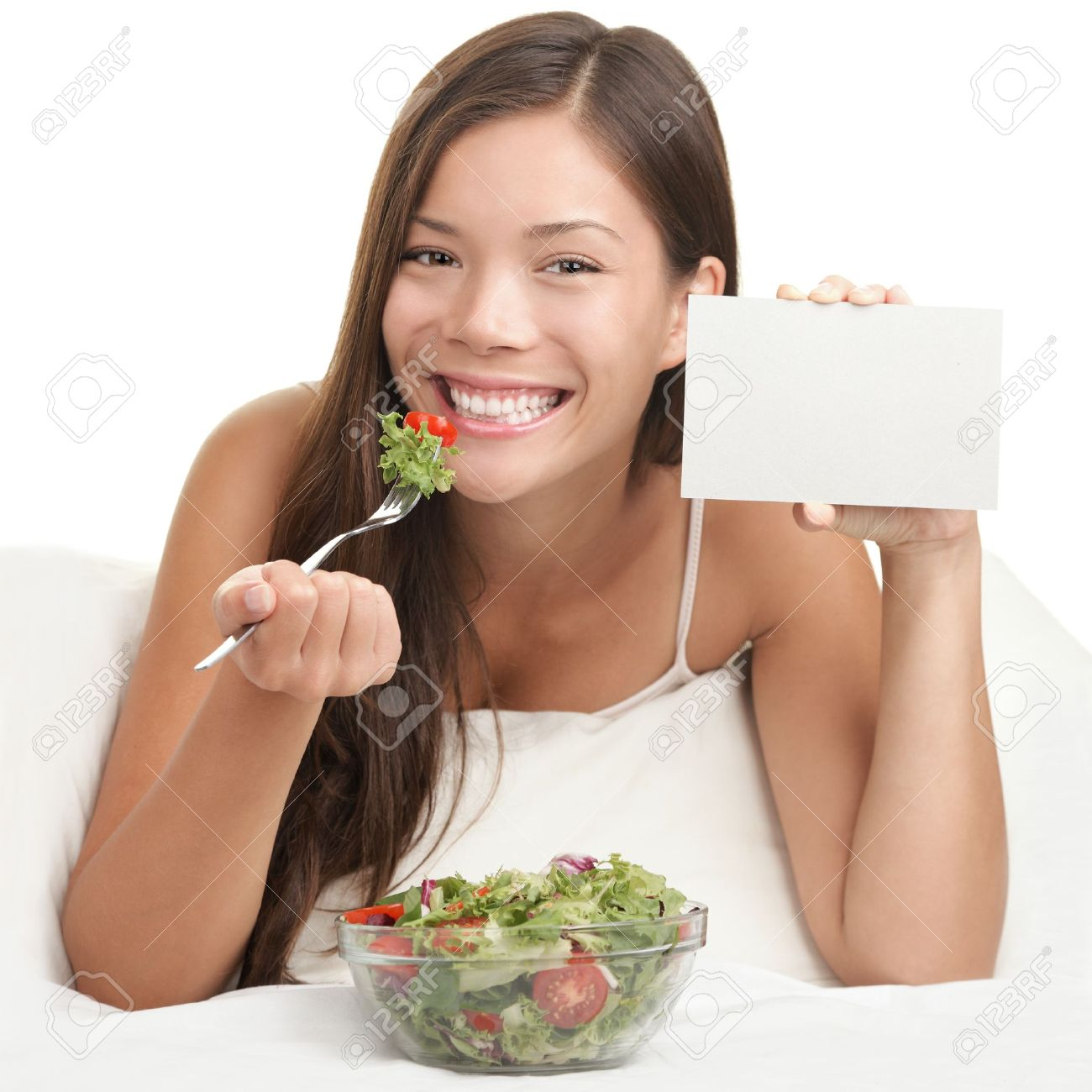 Salad copyspace. Woman eating salad showing blank sign with copy space. Healthy eating concept with young asian woman smiling looking at camera. Room for text. Stock Photo - 8361936
