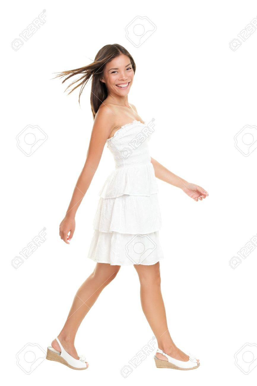 Woman in white dress walking isolated on white in full length.  Beautiful fresh smiling young mixed race Asian Caucasian female model in cute summer dress. Stock Photo - 9407147