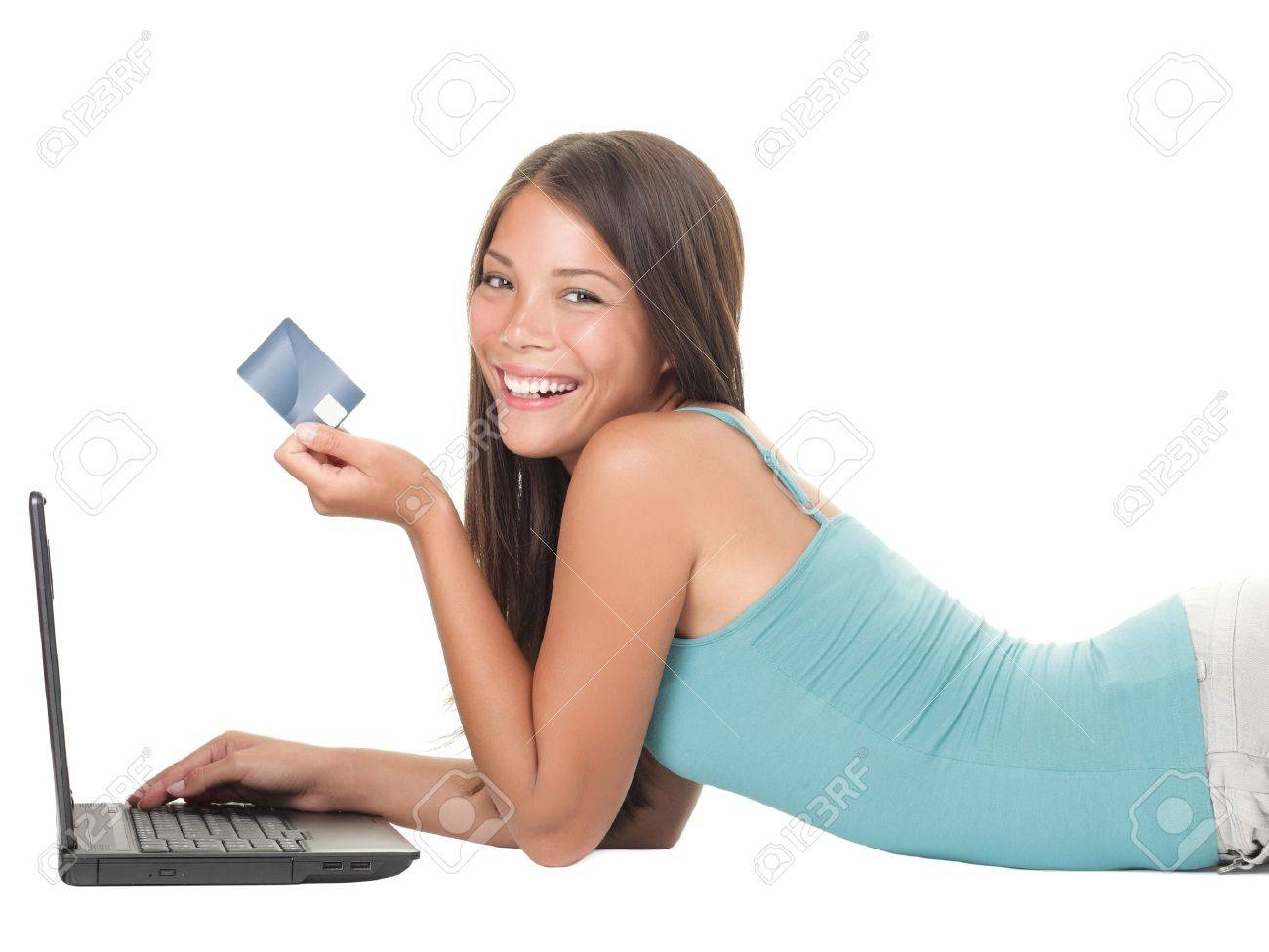 Woman shopping on internet using credit card. Young asian caucasian woman lying down isolated on white background. Stock Photo - 9407150