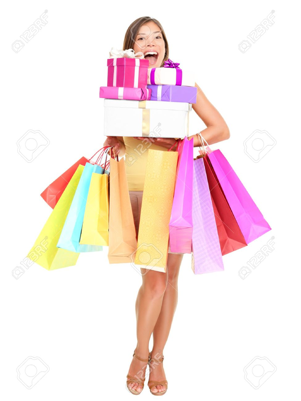 Shopper. Shopaholic shopping woman holding many shopping bags excited. Isolated portrait of young woman in full body on white background. Stock Photo - 9607538