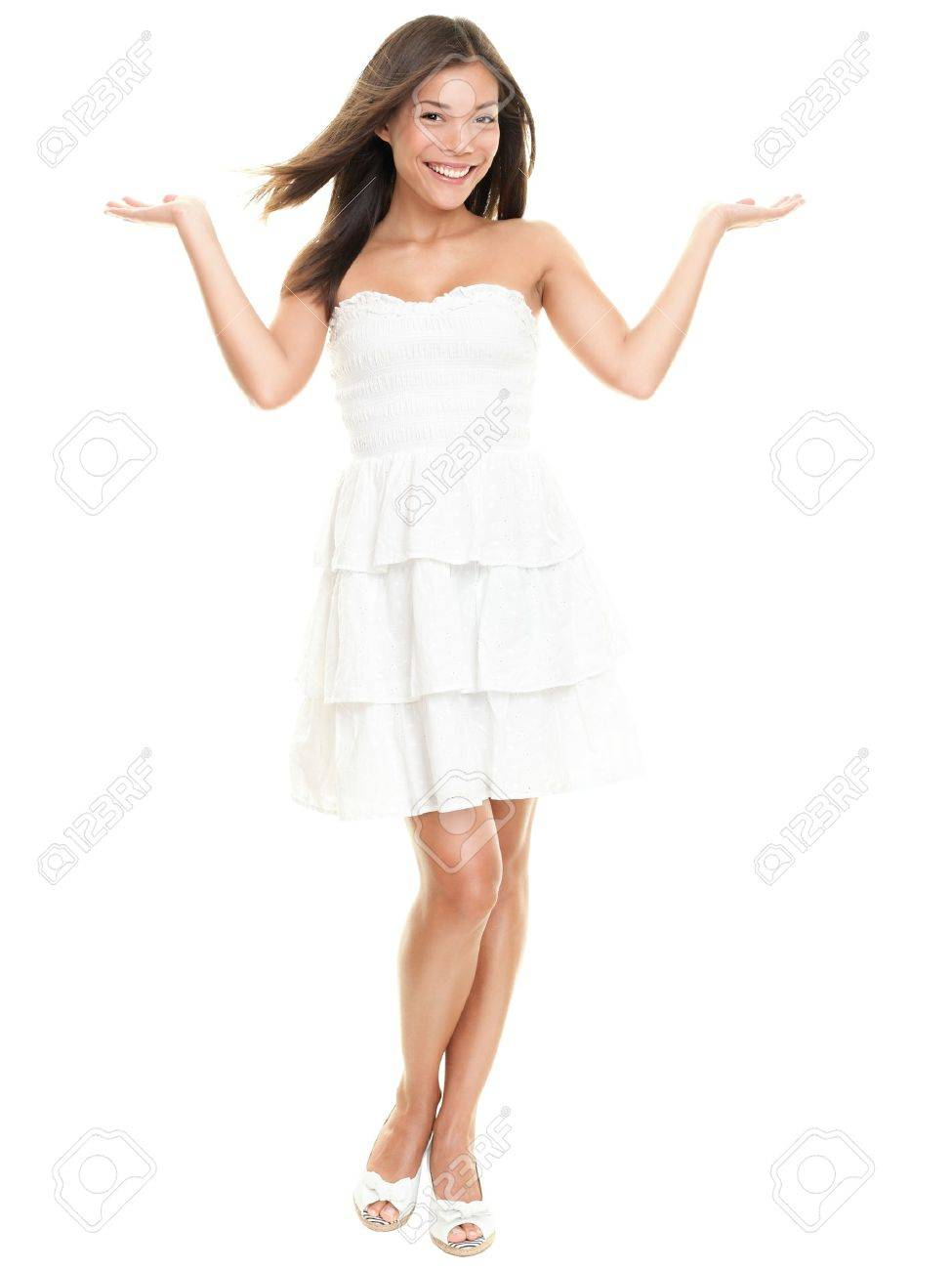 4ad77d85d Stock Photo - Woman showing with two open hands. Beautiful lovely girl in  white summer dress isolated on white background in full body.