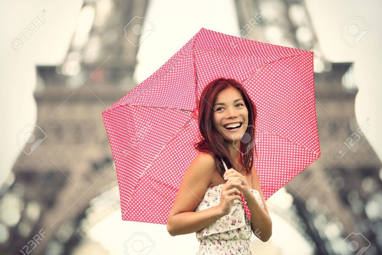 Paris Eiffel Tower Woman happy smiling in front of tourist attraction Eiffel Tower. Joyful fresh Caucasian Asian girl laughing. Stock Photo - 9952946