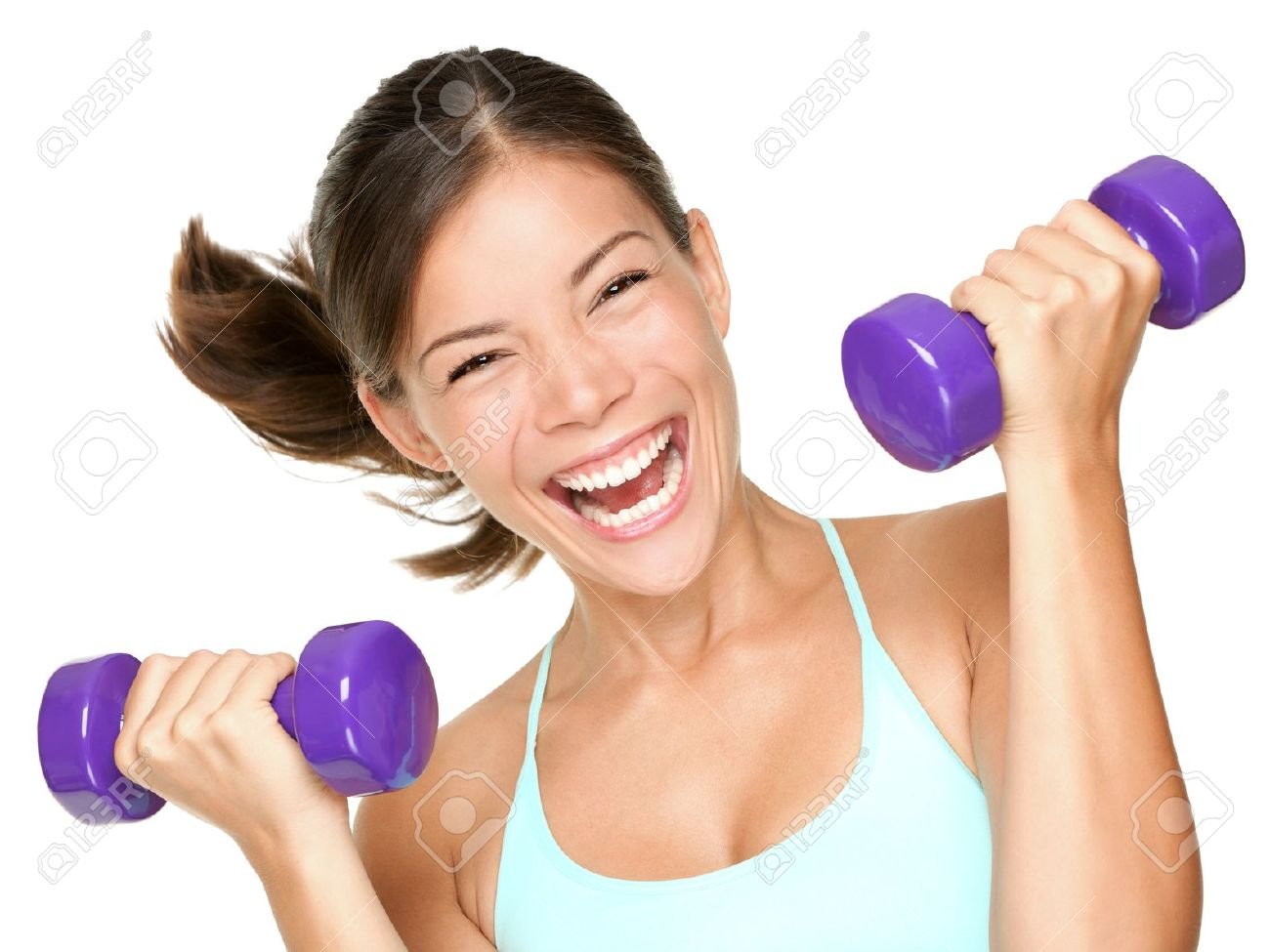 Happy fitness woman lifting dumbbells smiling cheerful, fresh and energetic. Mixed race Asian Caucasian fitness girl training isolated on white background. Stock Photo - 10097661