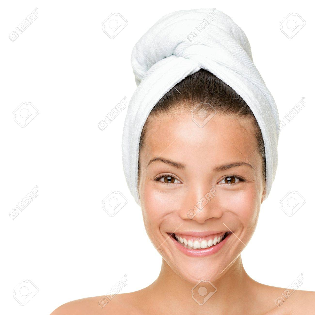 Beauty spa treatment woman wearing towel drying hair. Closeup portrait of happy smiling beautiful Caucasian / Asian female model isolated on white background. Stock Photo - 10465308