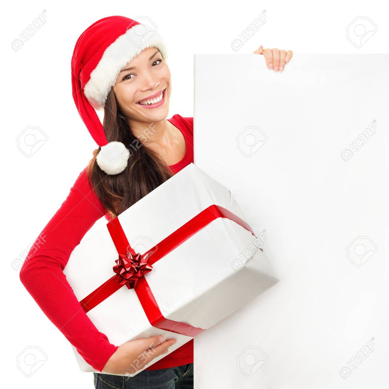 Beautiful christmas woman in santa hat holding empty board sign isolated on white background. Stock Photo - 10620697