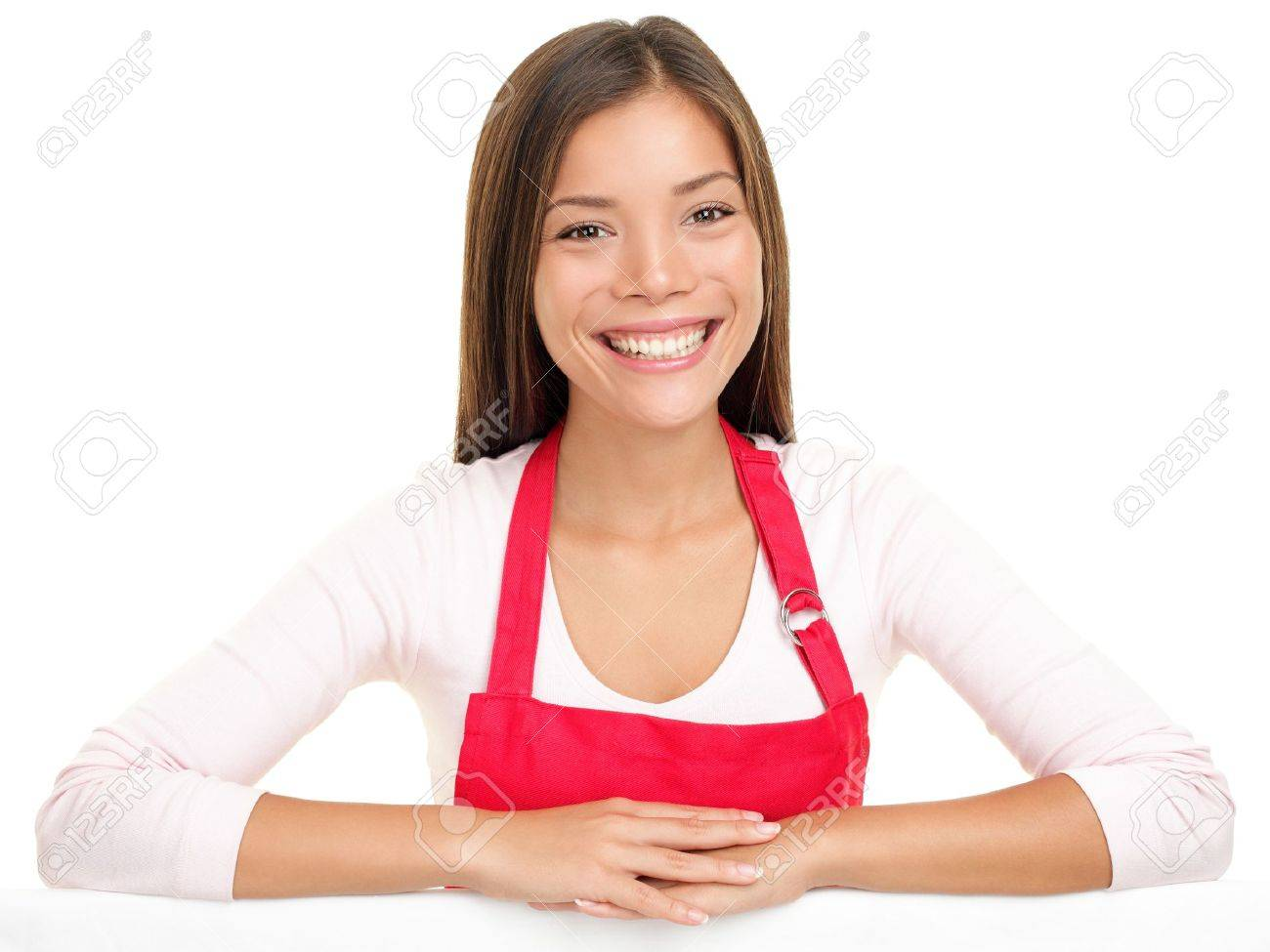 apron w  sales assistant clerk smiling happy with arms on    stock photo   apron w   s assistant clerk smiling happy   arms on edge for sign or similar  beautiful content and joyful female model isolated on