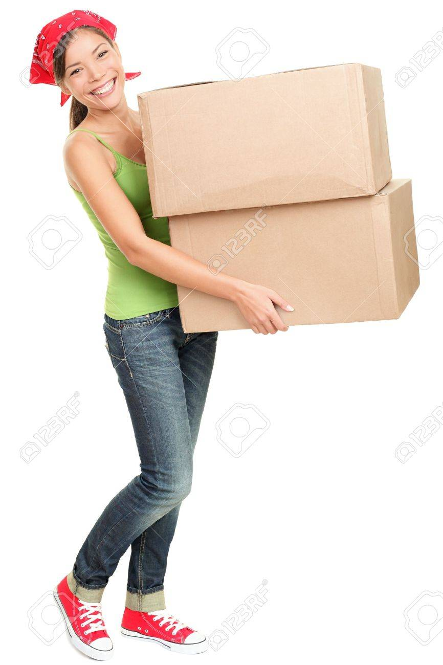 Woman carrying moving boxes. Young woman moving house to new home holding cardboard boxes isolated on white background standing in full length. Stock Photo - 10995375