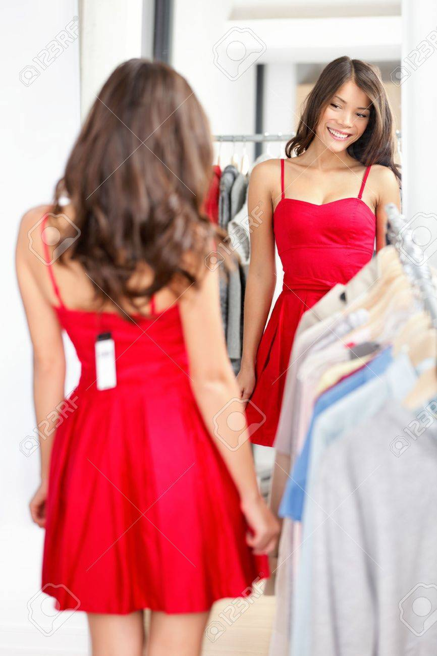 Woman trying red dress shopping for clothing. Stock Photo - 12357180