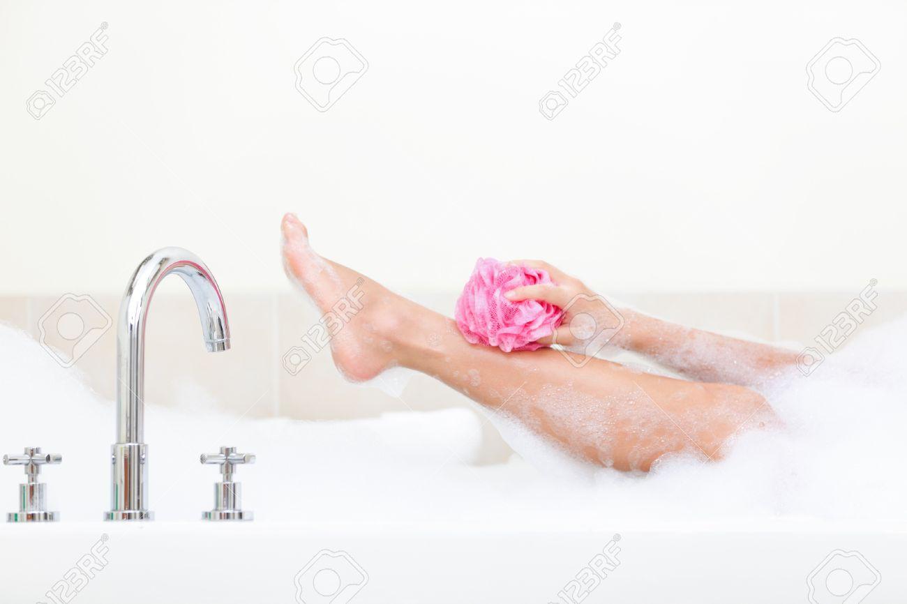 Woman in bath washing leg in bathtub with a lot of bubble bath foam. Stock Photo - 12357186