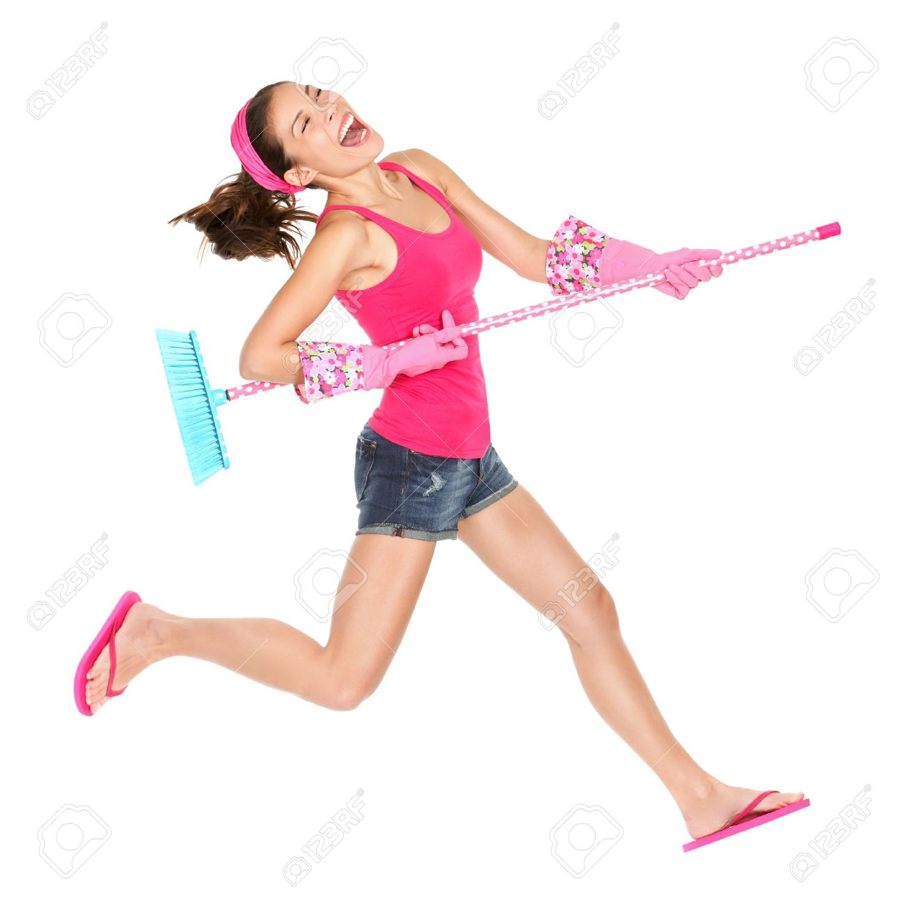 Cleaning woman jumping happy excited during spring cleaning fun. Stock Photo - 12357188
