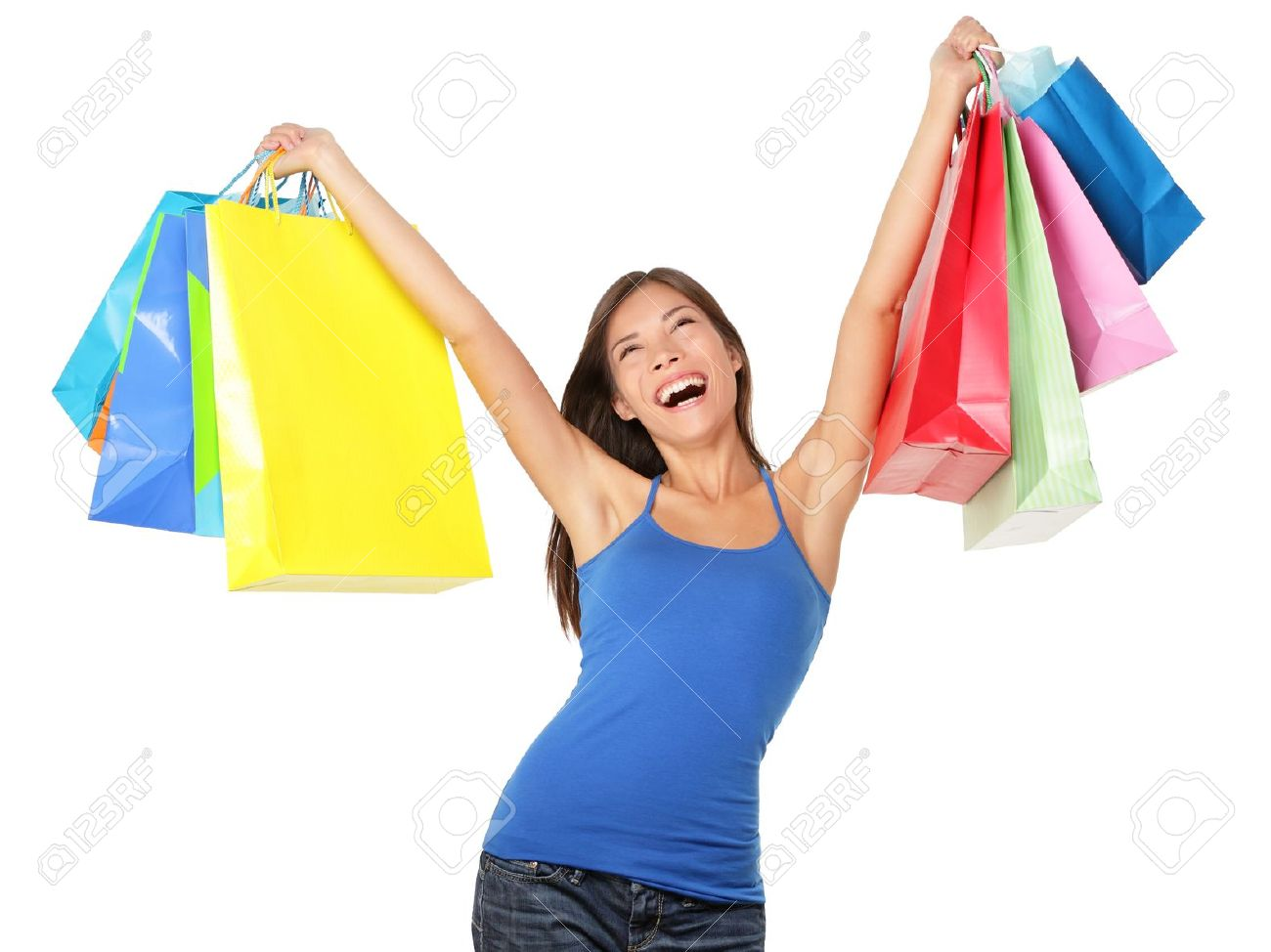 807d17539e753 Happy shopping woman excited and cheerful in joyful bliss. Shopper holding  many colorful shopping bags