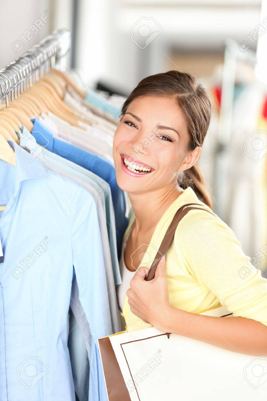 Tired Woman Yawning While Shopping Clothes In Clothing Store