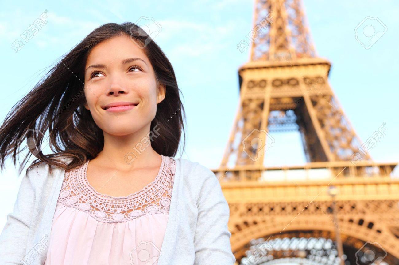 Eiffel tower Paris tourist woman smiling happy  Beautiful portrait of multiracial Asian Caucasian girl during travel in Europe Standard-Bild - 16637280