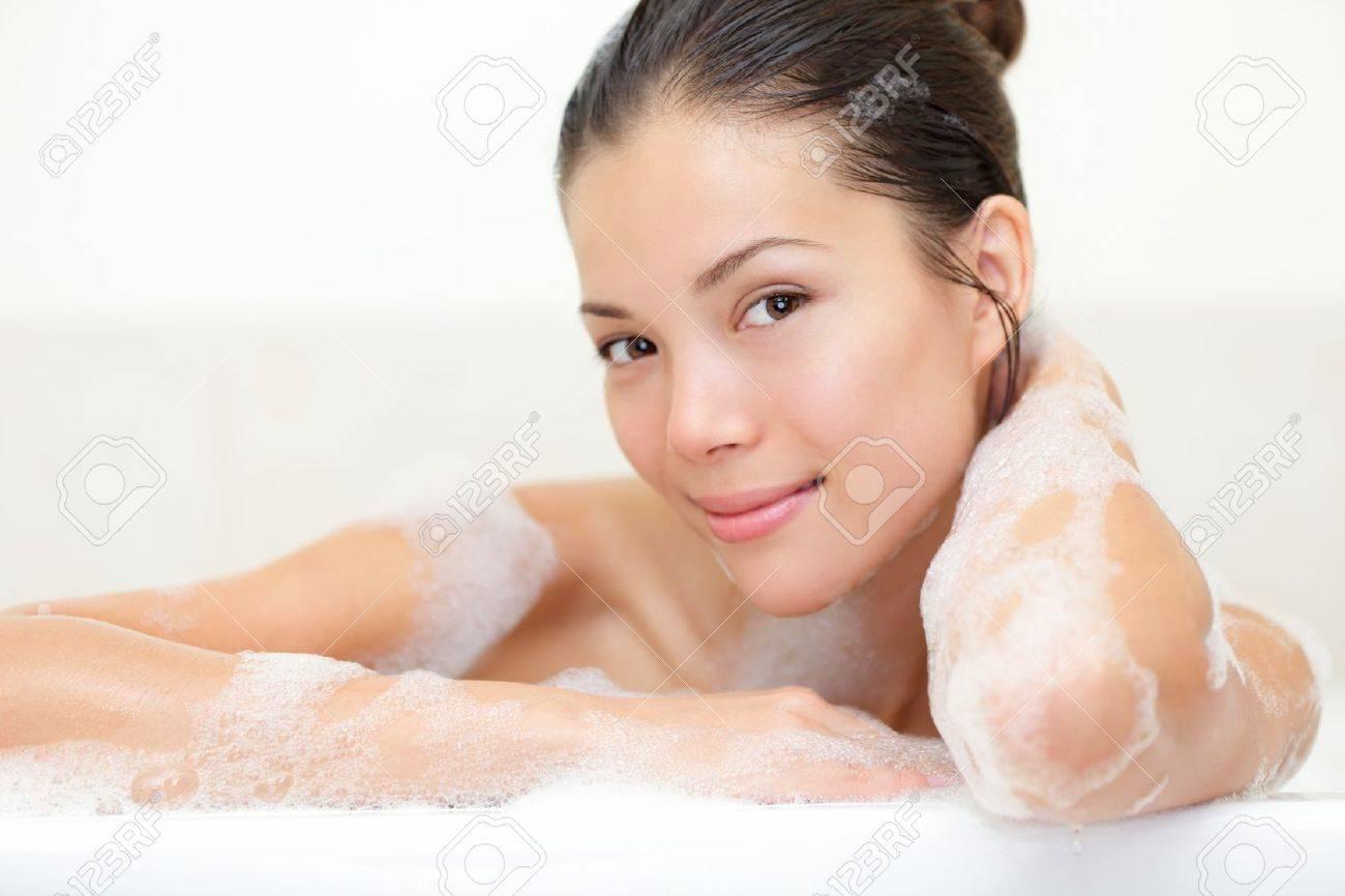 Beauty portrait of woman in bathtub with bath foam smiling happy looking serene at camera Standard-Bild - 16663411