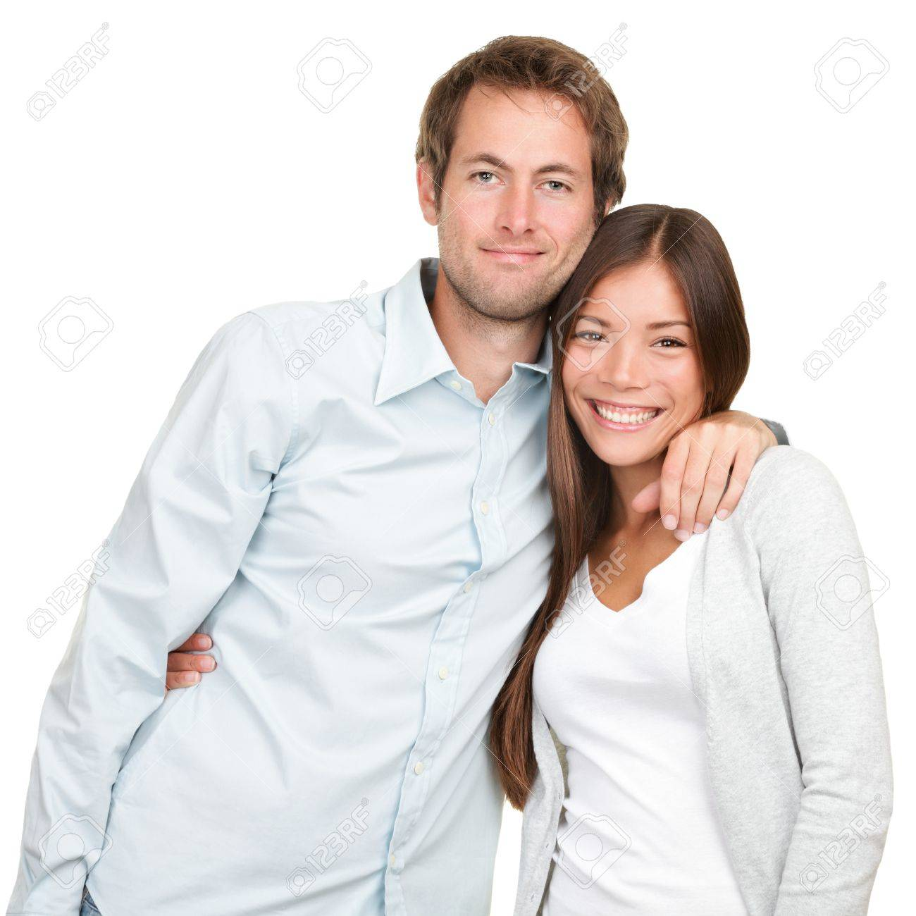 Happy young couple. Portrait of cheerful multiracial couple smiling looking at camera. Asian woman, Caucasian man. Standard-Bild - 16793346