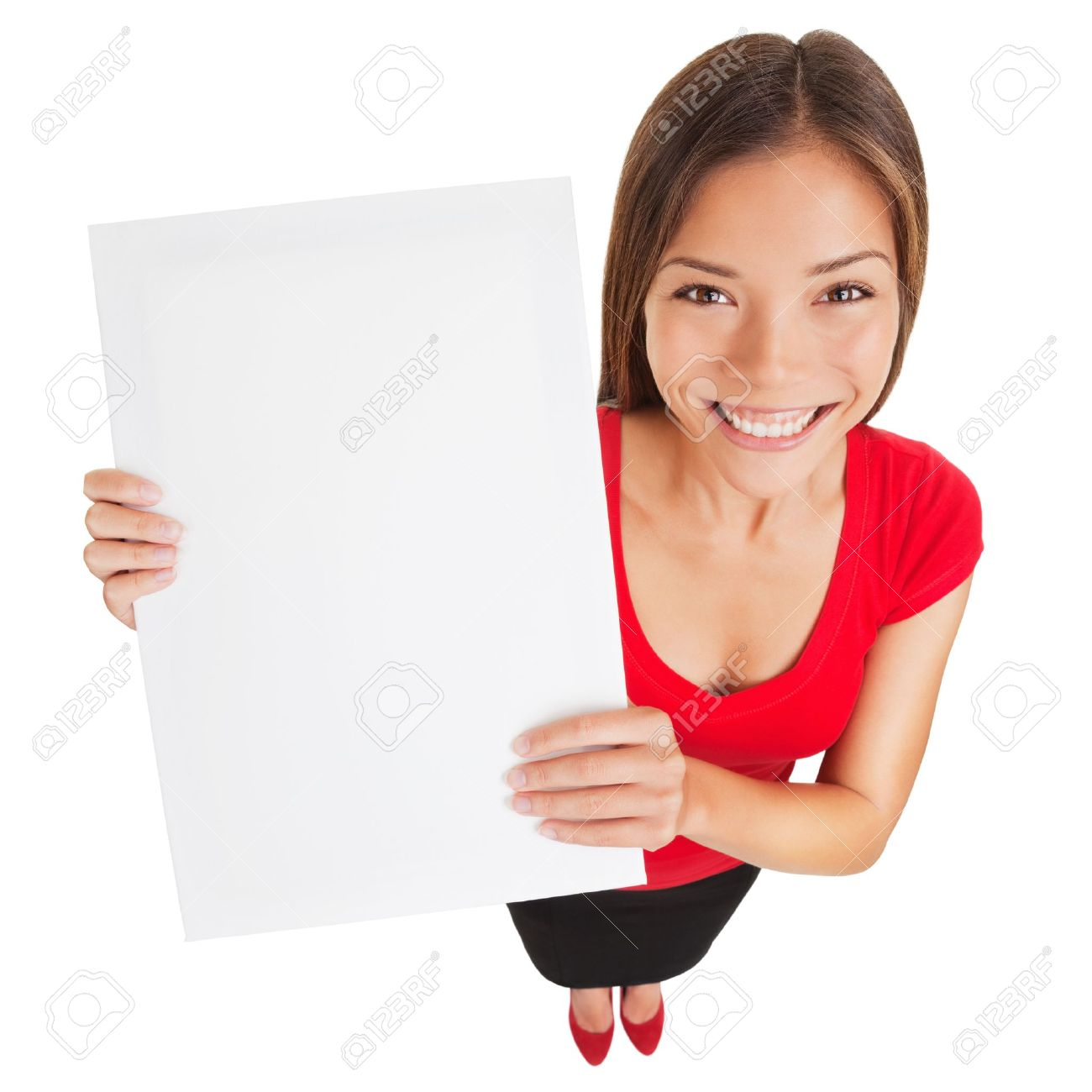 Sign woman showing blank poster billboard  Portrait in high angle perspective of beautiful charming woman with lovely smile holding up a blank white sign for your attention isolated on white background Standard-Bild - 18871927