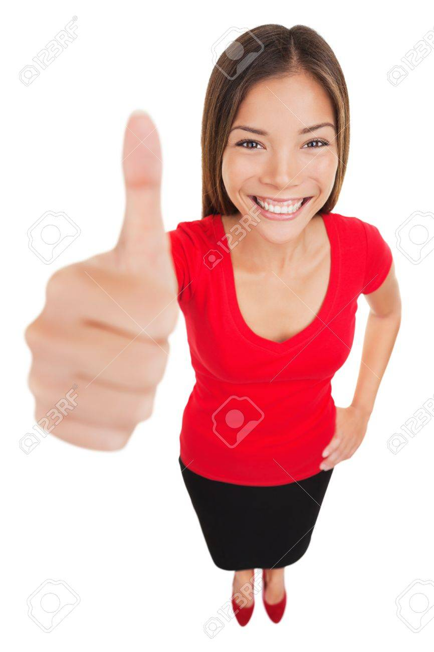 Woman giving thumbs up approval hand sign gesture smiling happy isolated on white background in full body length in high angle perspective view. Content smile on multiracial asian caucasian woman. Standard-Bild - 20047449