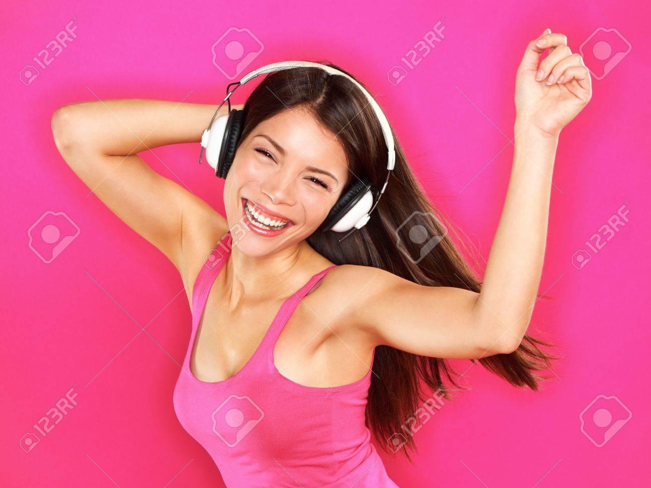 woman wearing headphones Standard-Bild - 21462885