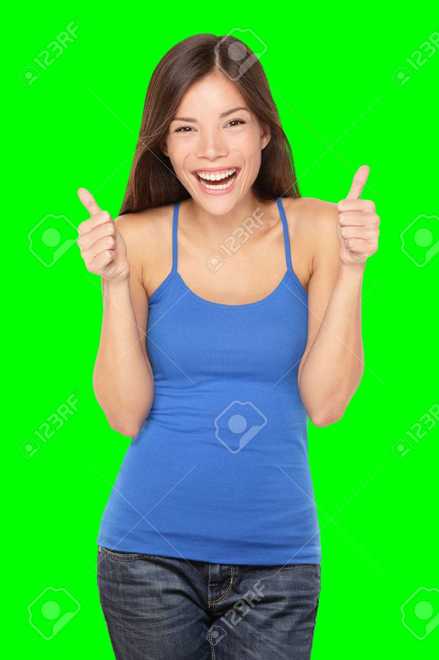 Happy woman giving thumbs up success hand sign smiling joyful and happy. Pretty young multiracial Asian / Caucasian female model in tank top. Isolated on green screen chroma key background. Standard-Bild - 39266671