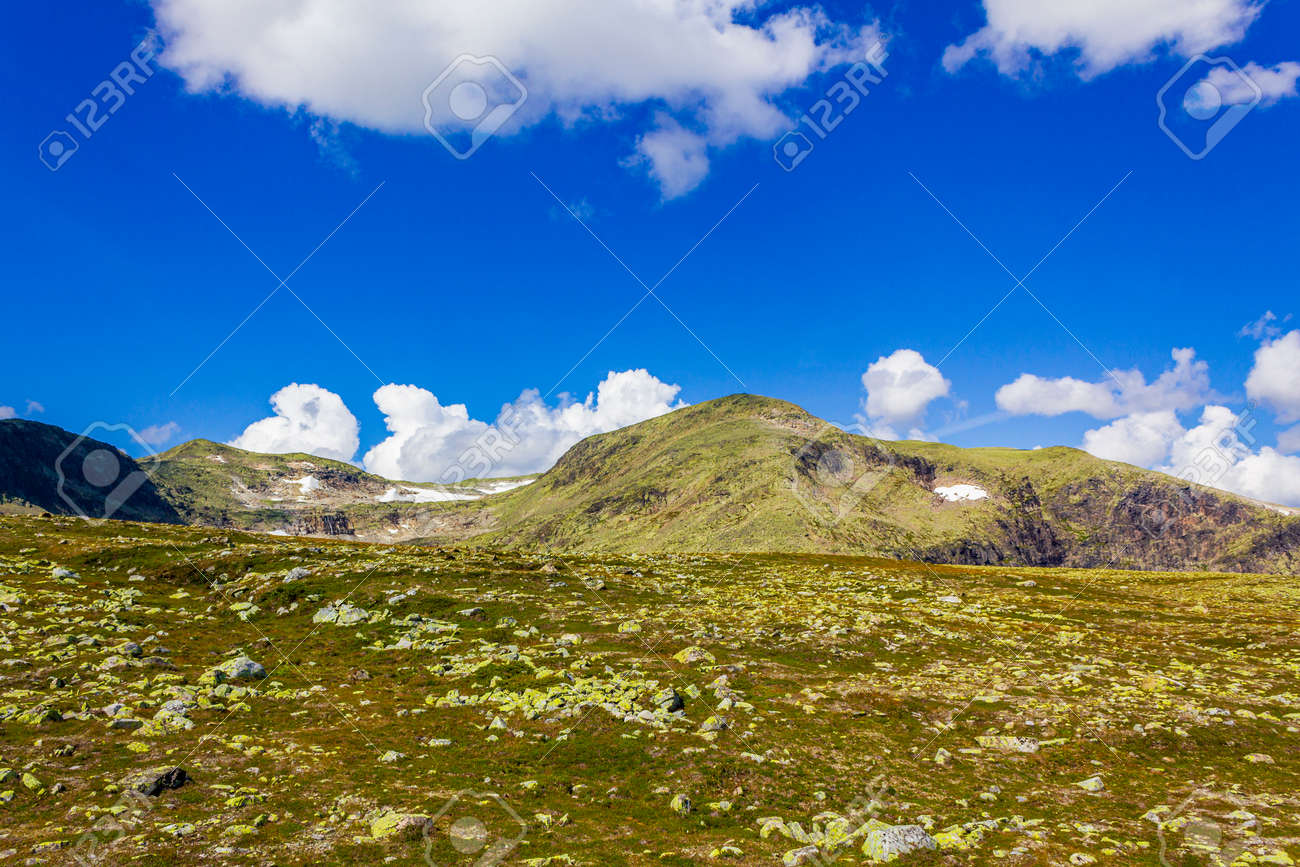 Amazing norwegian landscape with boulders at the summit on the mountain top in Vang i Valdres Norway. - 162325750