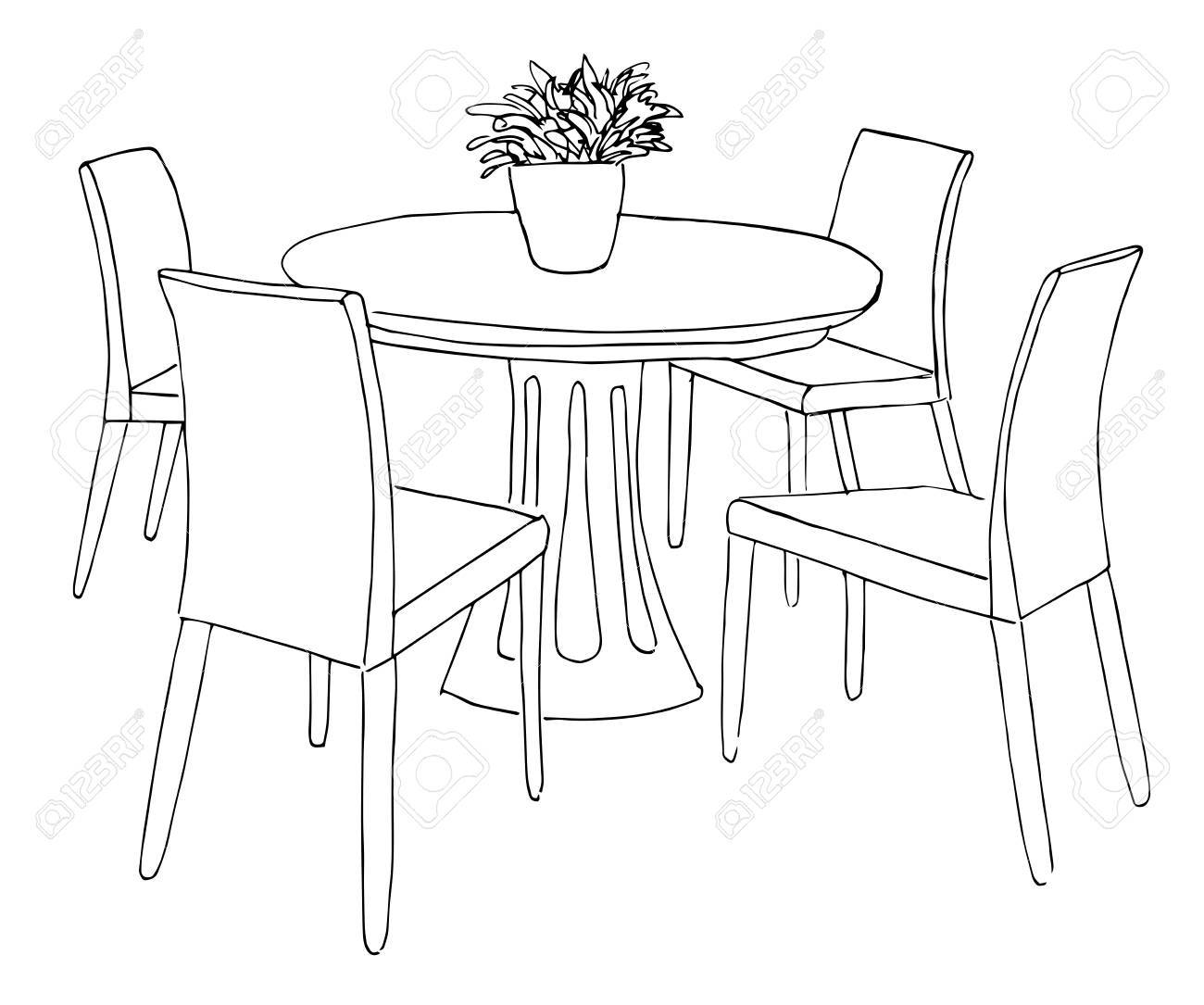 Part Of The Dining Room Round Table And ChairsOn The Table