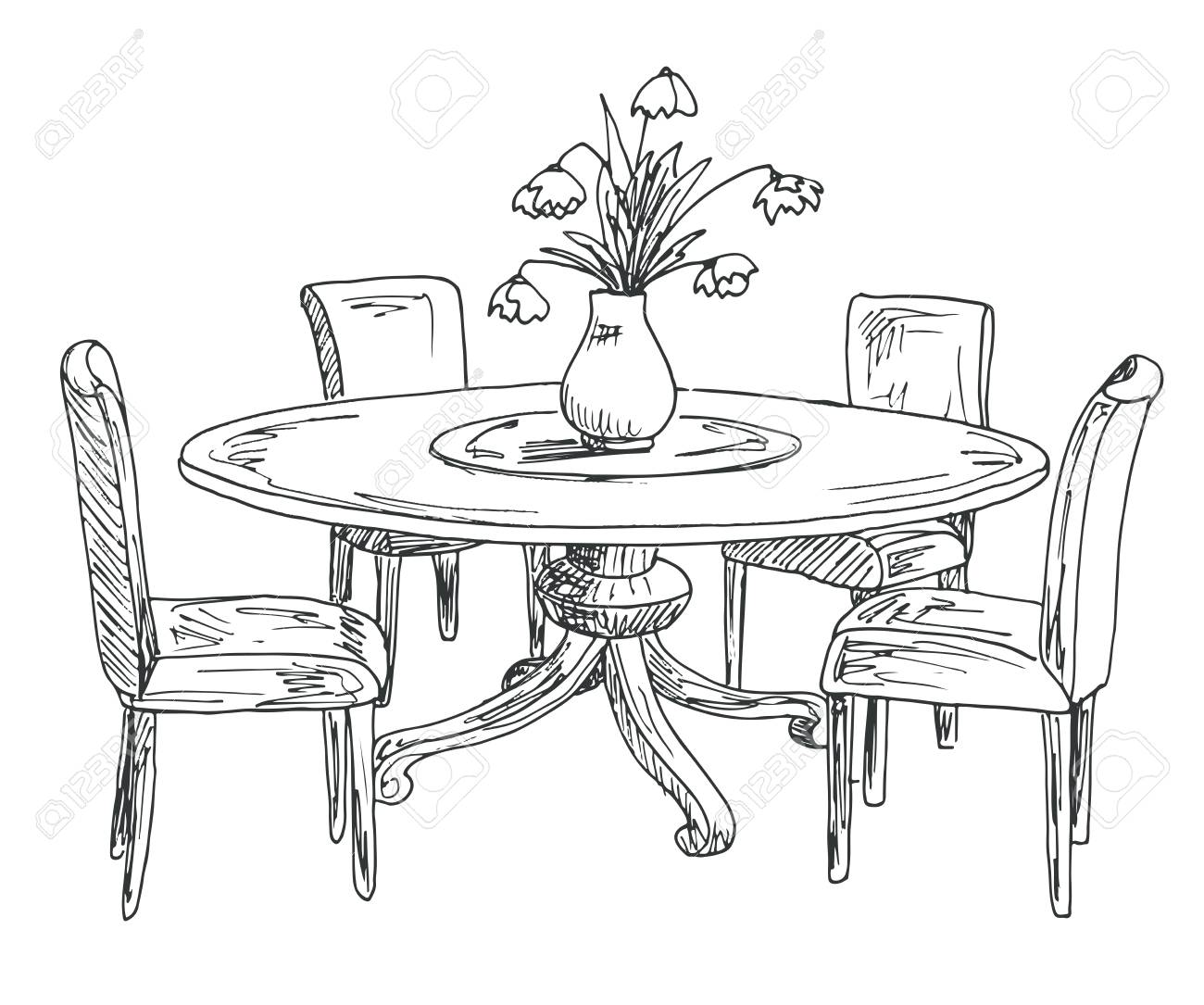 Part of the dining room. Round table and chairs.On the table..