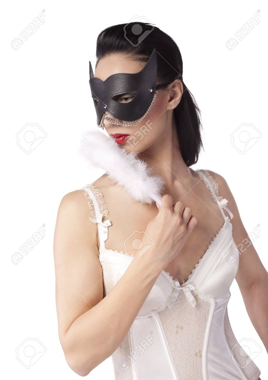 A girl in a black mask and a fan Stock Photo - 9964706