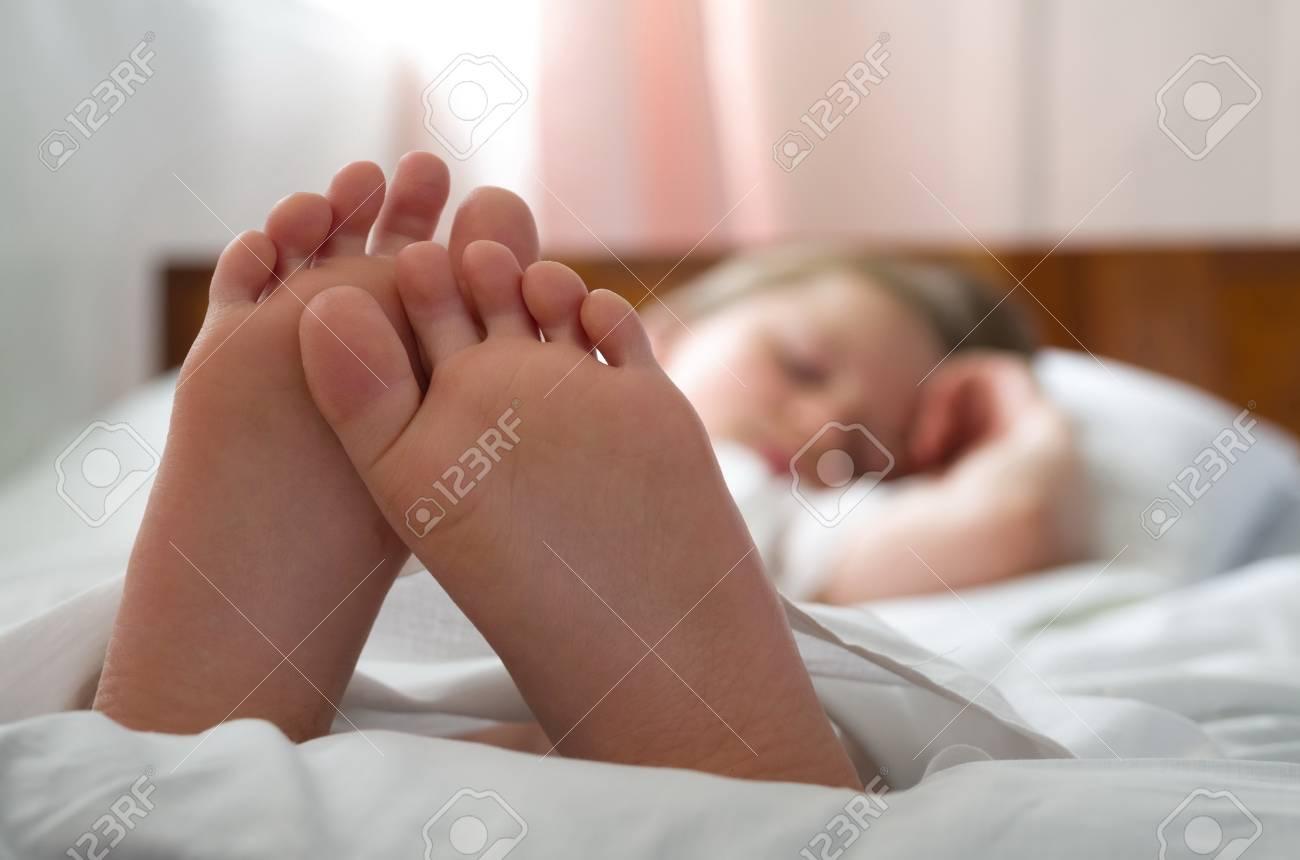 Little Girls Feet Who Sleeps Inher Bed Closeup