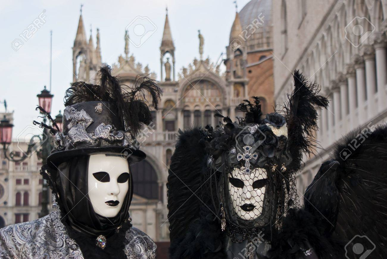 A pair of masks in front of the Basilica of San Marco, Italy Stock Photo - 13511942