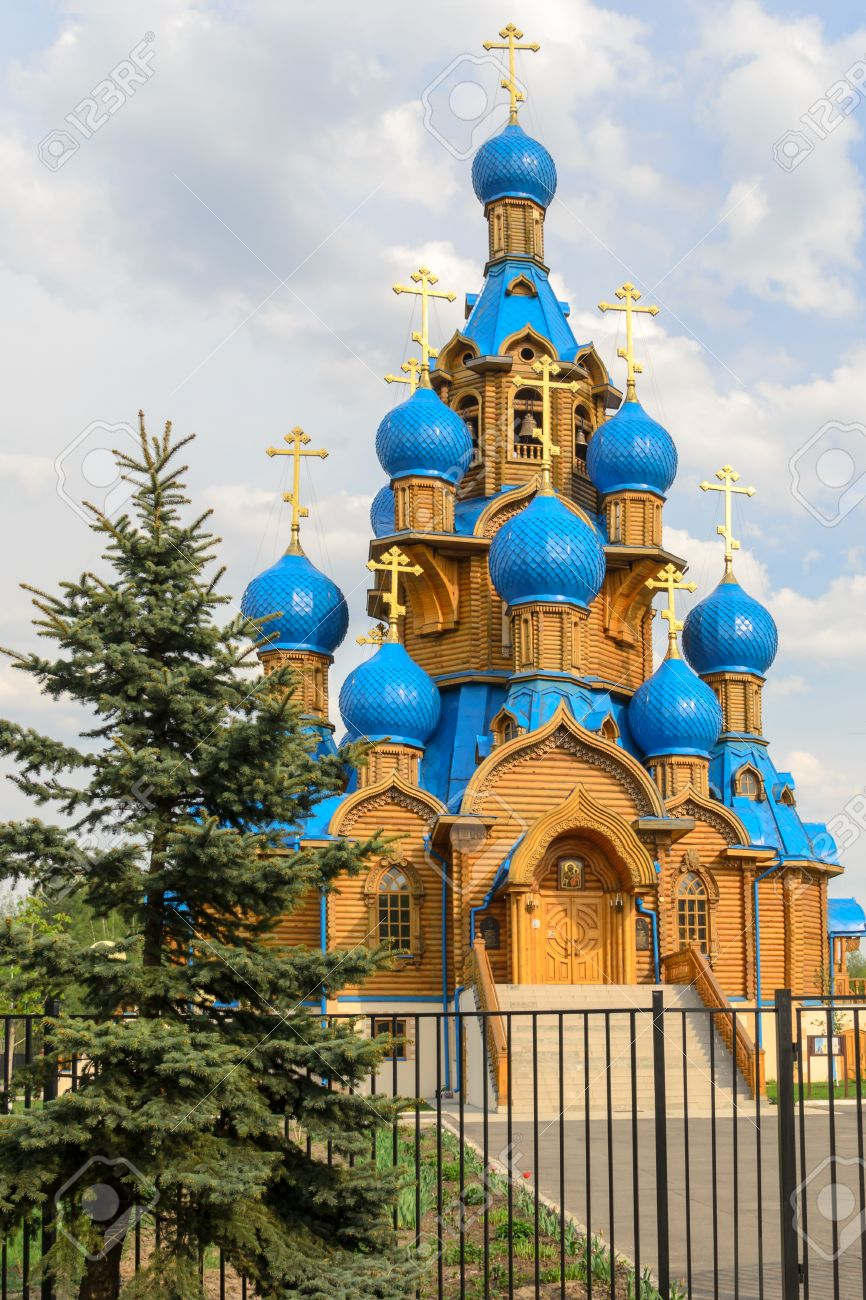 Russian Orthodox wooden church with beautiful blue domes on overcast, Moscow District, Russia Stock Photo - 37455471