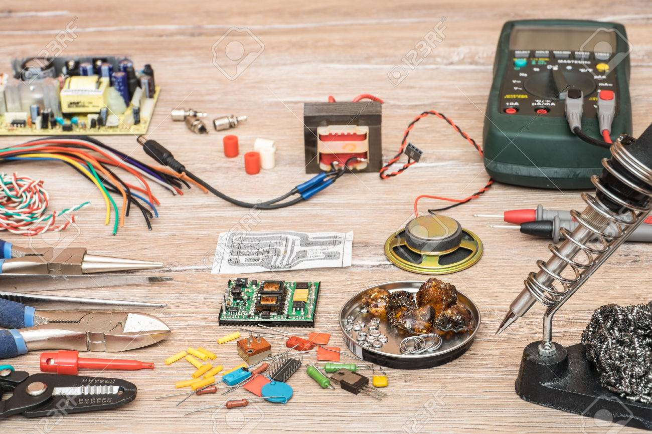 Tools For The Designing And Repair Of Electronic Devices Soldering Technician Repairing Circuit Board With Iron Stock Photo Components Wire Multimeter On A
